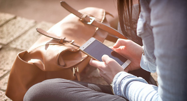 Girl on smartphone 650 x 350.png