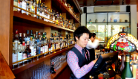 Serving at the Elysian Whiskey bar.png