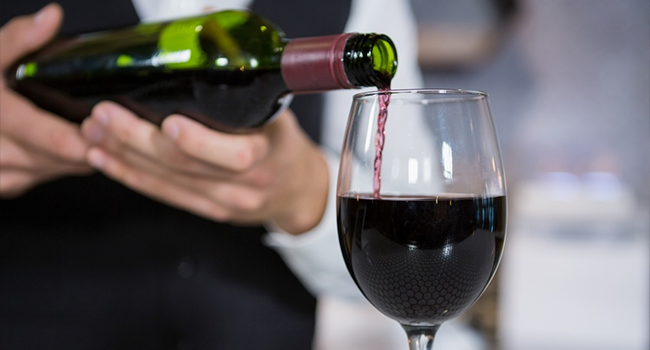 Wait staff correctly pouring a bottle of wine.png