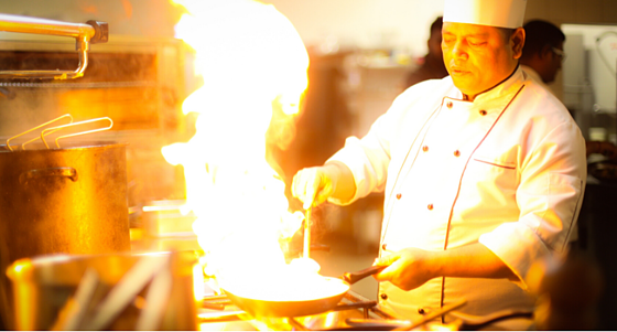 Chef with flaming pan