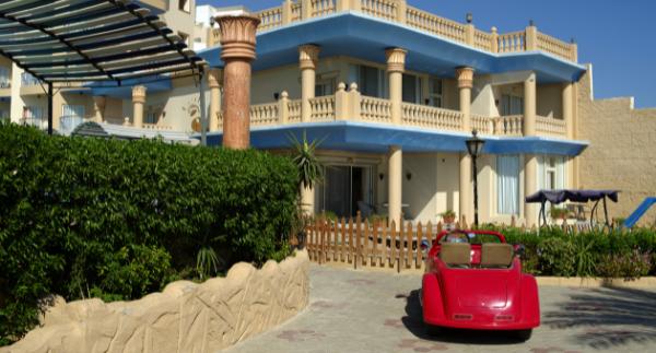 Luxury vehicle outside hotel