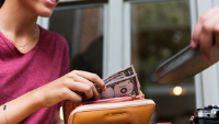 Woman paying for meal in cash