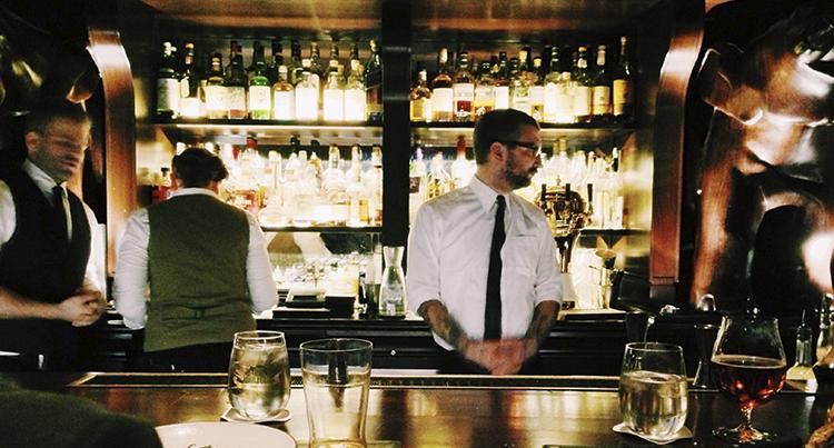 hotel bartender serving drinks